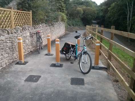Rather large Cargo bike negotiating the 1.2m gap in the 5 bollards on the Claude Avenue Ramp.
