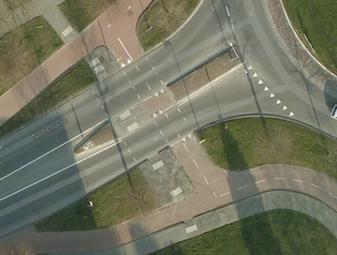 Close up of the space the pedestrians and cyclists interact with the vehicles coming off/on the roundabout. Good visibility at all times.