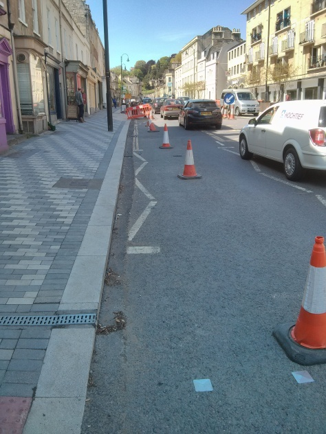 Cones showing the width of the to be painted cycle lane. Note cones by Snow Hill are crushed as people push round cars trying to turn into Snow Hill.