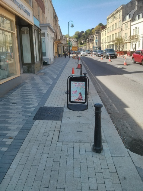 Businesses putting signs in the cycle track. Not unnecessary work sign in the cycle track.
