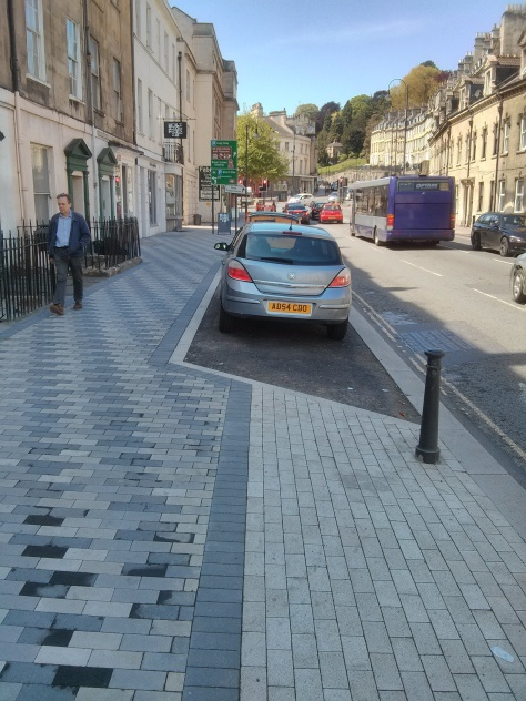 30 minute loading bay interrupts cycle track and forces dangerous interaction between cyclists and pedestrians.