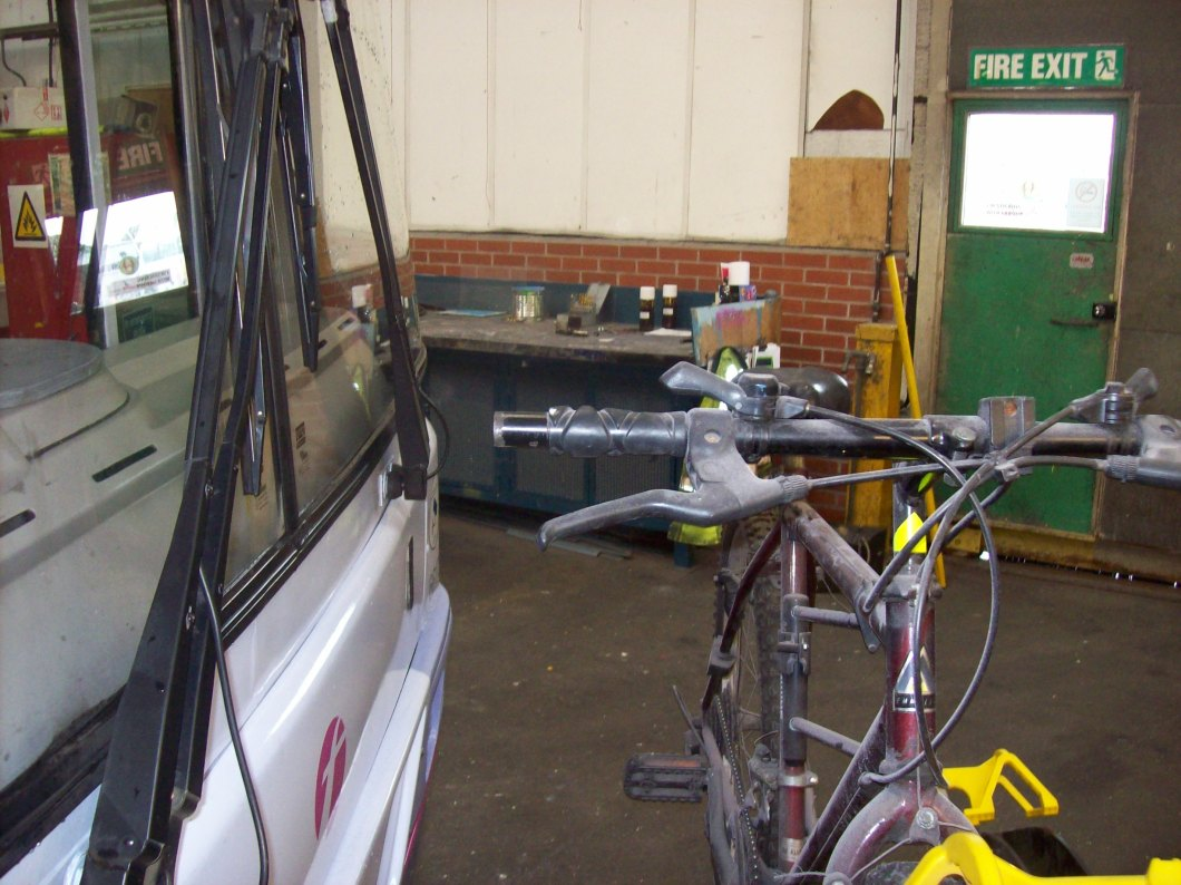Cycle rack with one bike in place. Note distance of handlebar from glass.