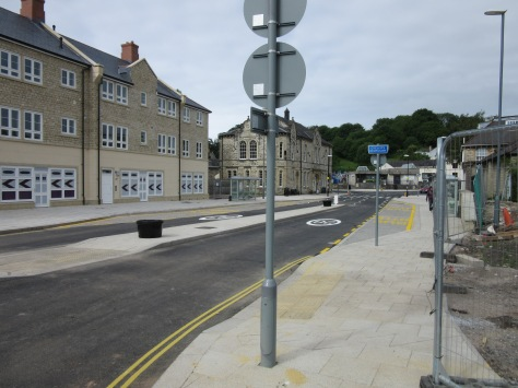 No bus stop bypasses. Cyclists should dismount if they feel they cannot confidently take the road the road.