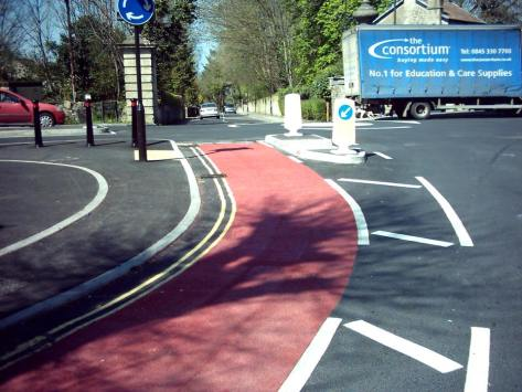 The Combe Down Roundabout. Paint in red shows the cycle lane. This should be used (or something similar) to mark out explicitly the cycle contraflows. It's crazy not to.